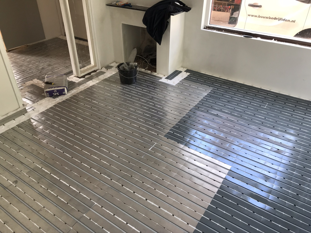 Aanbrengen vloerverwarming op bestaande houten vloer.